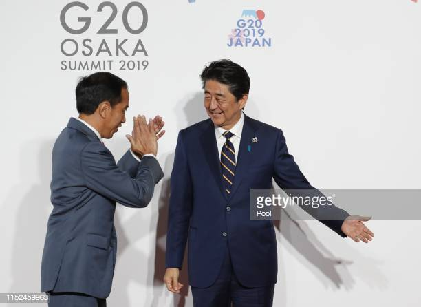 Indonesian President Joko Widodo is welcomed by Japanese Prime Minister Shinzo Abe before a family photo session at G20 summit on June 28, 2019 in...