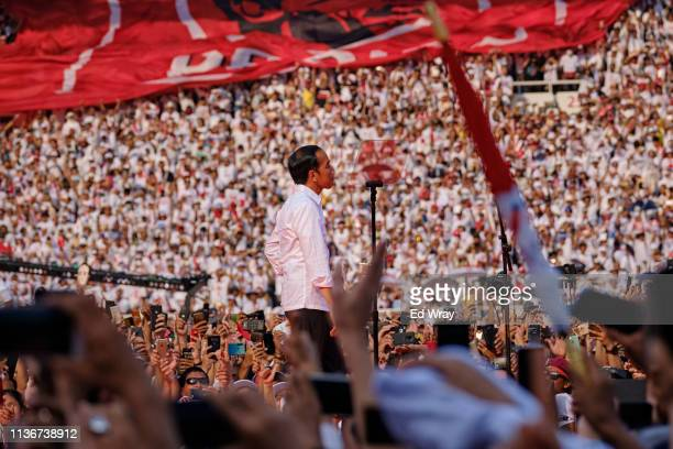 Indonesian President Joko Widodo, popularly known as Jokowi, approaches the microphone to give a speech to supporters at a rally at Jakarta's main...