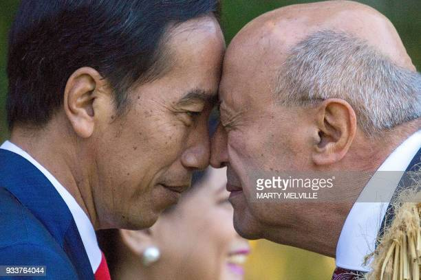 Indonesian President Joko Widodo receives a Maori Hongi from a Maori elder during ceremony of welcome for Widodo at Government House in Wellington,...