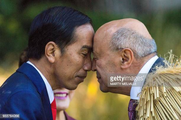 Indonesian President Joko Widodo receives a Maori Hongi from a Maori elder during ceremony of welcome for Widodo at Government House in Wellington...