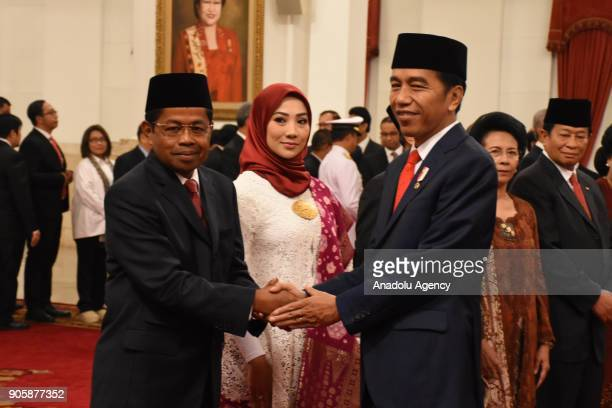 Indonesian President Joko Widodo shakes hands with Idrus Marham after inauguration at the State Palace in Jakarta Indonesia on January 17 2018 The...