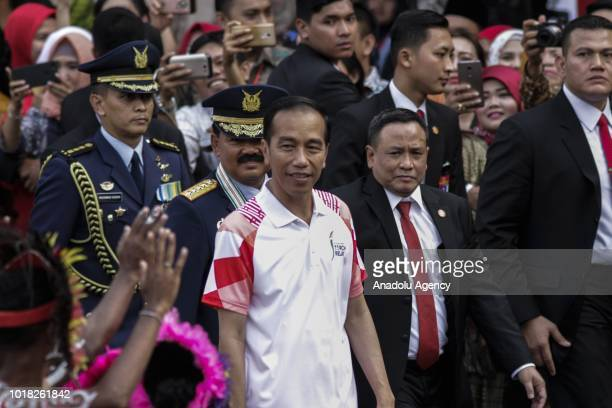 Indonesian President Joko Widodo walks with TNI Commander Marshal Hadi Tjahjanto as they wait for the arrival of the 2018 Asian Games torch bearers...