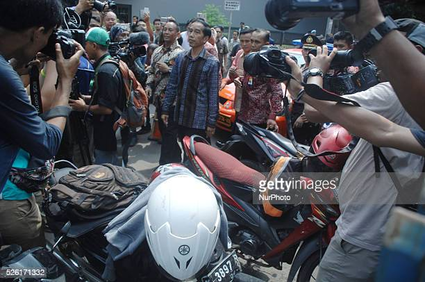 Indonesian President Joko Widodo waves as he passes the site of a bombing a day after a blast in front of a shopping mall in Jakarta Indonesia 15...