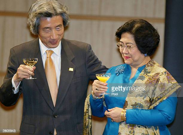 Indonesian President Megawati Sukarnoputri whose nation is charing the Association of Southeast Asian Nations summit this year toasts with Japanese...
