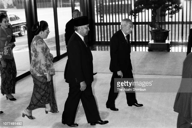 Indonesian President Suharto and his wife Siti Hartinah are welcomed by Emperor Hirohito prior to their meeting at the Imperial Palace on October 21...