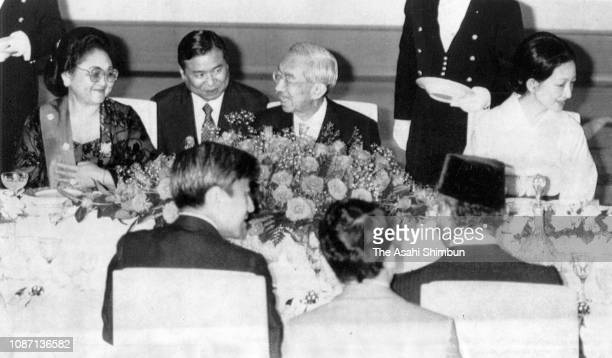 Indonesian President Suharto and his wife Siti Hartinah talk with Emperor HirohitoCrown Prince Akihito and Crown Princess Michiko during their...