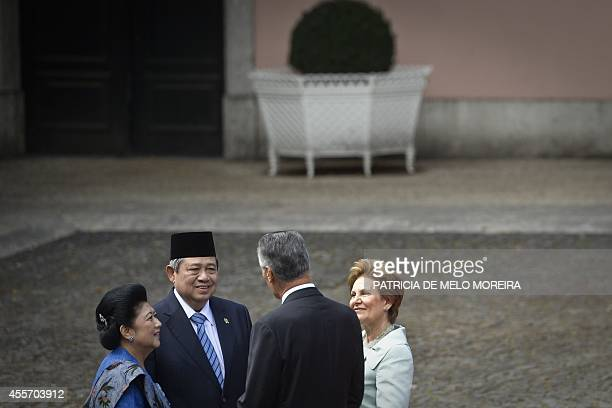 Indonesian President Susilo Bambang Yudhoyono and his wife Ani Bambang Yudhoyono are welcomed by Portuguese President Anibal Cavaco Silva and his...