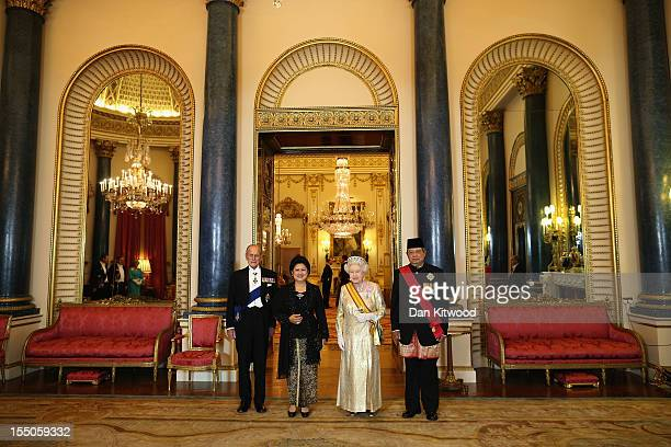 Indonesian President Susilo Bambang Yudhoyono and his wife Ani Bambang Yudhoyono pose for a photograph with Britain's Queen Elizabeth II and Prince...