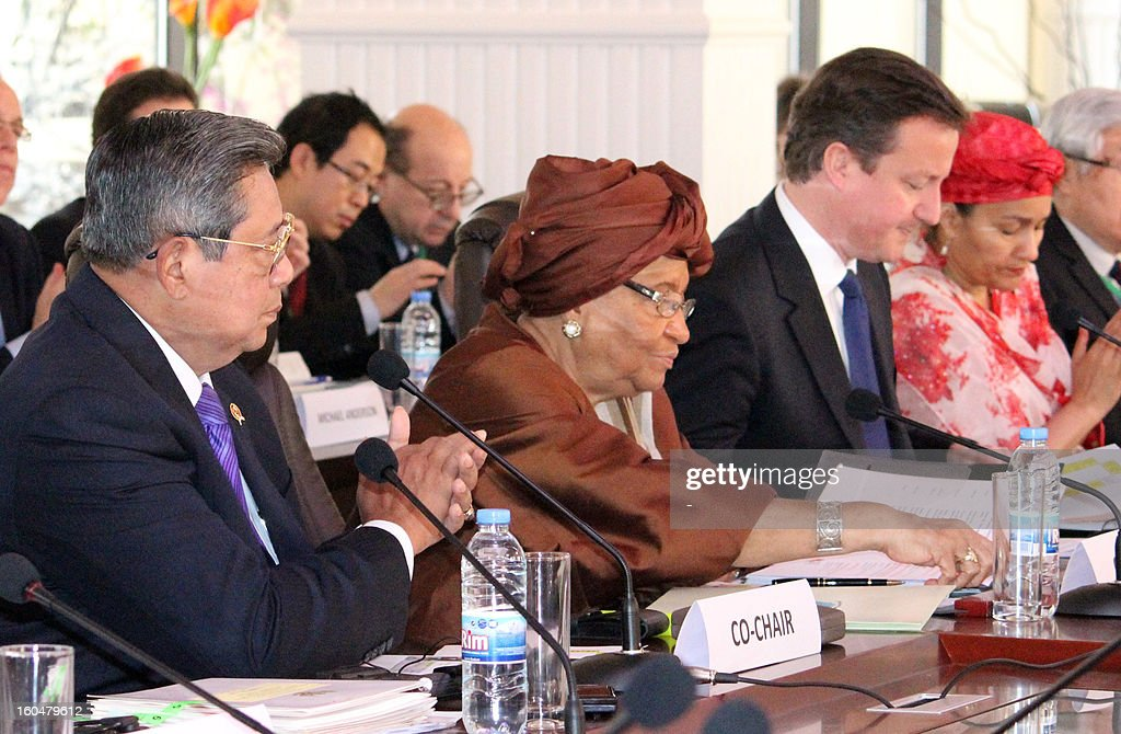 Indonesian President Susilo Bambang Yudhoyono, Liberian president Ellen Johnson Sirleaf and British Prime Minister David Cameron co-chair a high-level United Nations meeting on tackling global poverty in Monrovia on February 1, 2013. Cameron, who arrived in Monrovia late yesterday, toured the capital of the west African nation which is one of the world's most impoverished countries as it slowly rebuilds from a devastating civil war which ended a decade ago. DOSSO