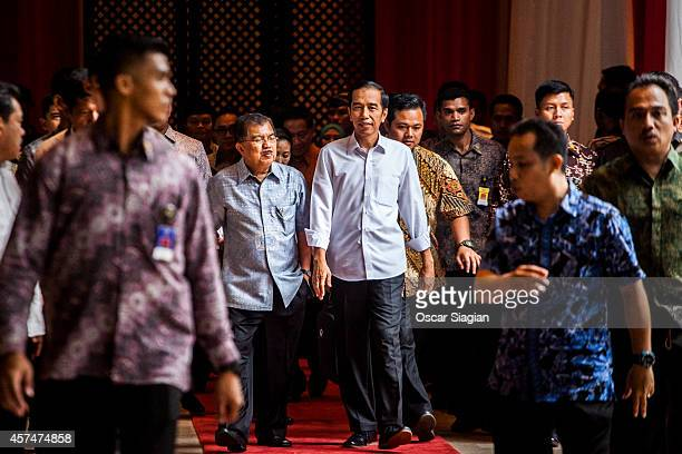 Indonesian President-elect Joko Widodo talk with Vice President-elect Jusuf Kalla after inauguration rehearsal on October 19, 2014 in Jakarta,...