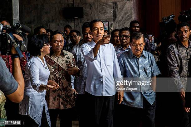 Indonesian President-elect Joko Widodo walk with Vice President-elect Jusuf Kalla after inauguration rehearsal on October 19, 2014 in Jakarta,...