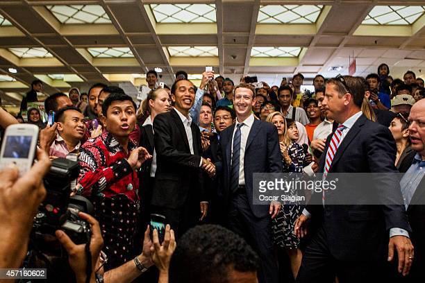 Indonesian President-elect Joko Widodo with Facebook founder Mark Zuckerberg shake hands at Tanah Abang Market the biggest textile market in South...
