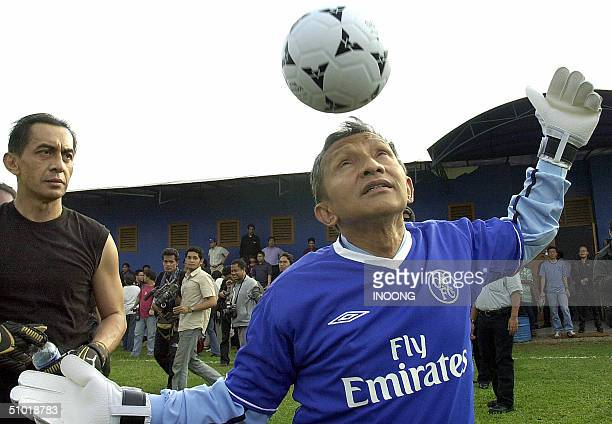 Indonesian presidential candidate Amien Rais heads the ball during a campaign visit to a football ground in Jakarta 02 July 2004 Rais is one of five...