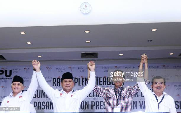 Indonesian presidential candidates Prabowo Subianto from the Gerindra Party and running mate Hatta Rajasa with Joko Widodo from the Indonesian...