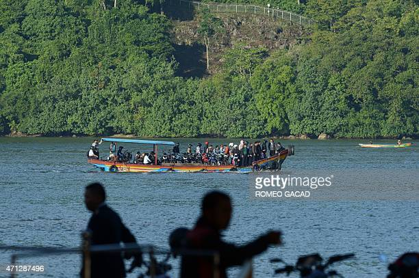 Indonesian prison officials and personnel ride a ferry to Nusakambangan maximum security prison island from the port in the town of Cilacap early on...