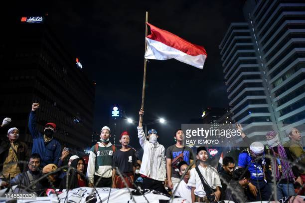 Indonesian protesters gather to demonstrate against Indonesia's President Joko Widodo's victory in the recent election in Jakarta on May 22 2019 At...