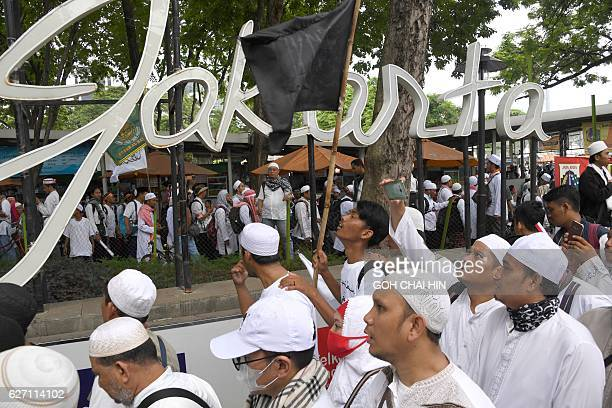 Indonesian protesters make their way to Jakarta's National Monument Park on December 2 2016 to take part in a rally against Jakarta's Christian...