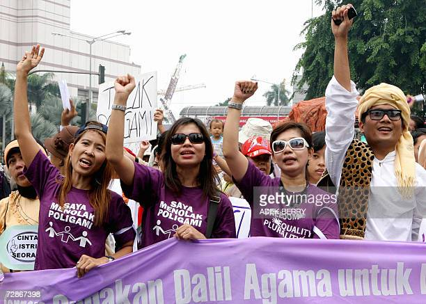 Indonesian protesters march during a demonstration against polygamy in Jakarta 22 December 2006 Indonesia is considering extending a ban on civil...