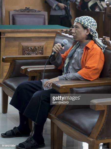 Indonesian radical cleric Aman Abdurrahman answers a judge's question during his first appearance at the South Jakarta court in Jakarta on February...