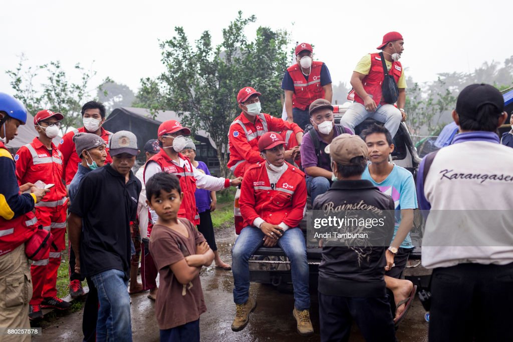 KARANGASEM, BALI, INDONESIA - NOVEMBER 27: Indonesian Red Cross and evacuees at Rendang Evacuation Center on November 27, 2017 in Karangasem, Island of Bali, Indonesia. Indonesian authorities raised the state of alert to its highest level for the volcano, Mount Agung, after thick ash started shooting thousands of meters into the air with increasing intensity. Based on reports, as many as 100,000 villagers will need to leave the expanded danger zone while tens of thousands of tourists have been stranded due to airport closures.