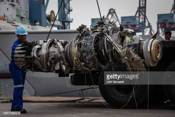 Indonesian rescue personnel recover the wreckage of an engine from the Lion Air flight JT 610 at Tanjung priok port on November 4 2018 in Jakarta...