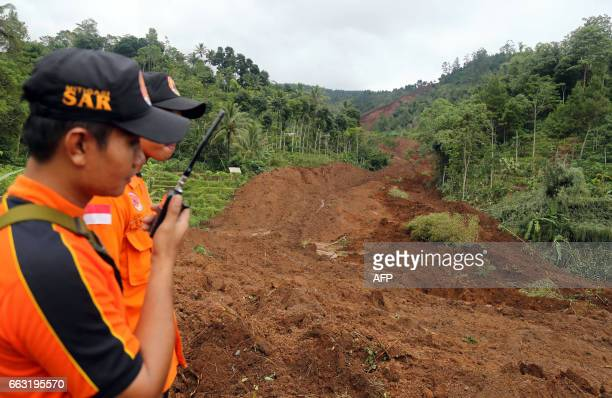 Indonesian rescuers look for survivors after a landslide hit Banaran village in Ponorogo East Java province on April 1 2017 Seventeen people have...