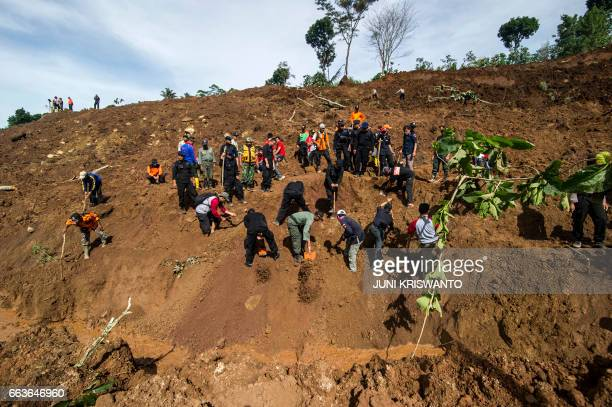 Indonesian rescuers search for survivors after a wall of mud slammed onto houses from a hillside after heavy rainfall in Ponorogo district East Java...