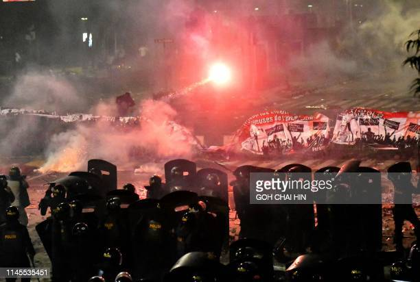TOPSHOT Indonesian riot fire tear gas at protesters demonstrating against the reelection of Indonesian president in Jakarta on May 22 2019 At least...