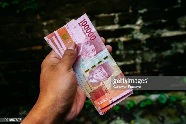 indonesian rupiah currency - indonesia stock pictures, royalty-free photos & images