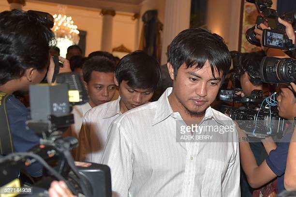Indonesian sailors arrive for a ceremony to hand hostages over to their families at the Foreign Ministry office in Jakarta on May 2 after ten...
