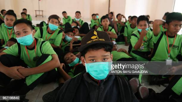 Indonesian schoolchildren wear masks at school after mount Merapi erupted in Sleman on May 11 2018 Indonesian villagers living in the shadow of one...