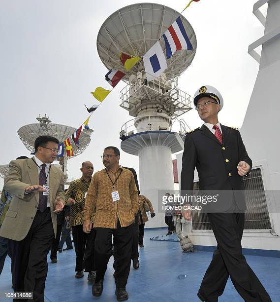 Indonesian science and technology officials accompanied by a Chinese ship official tour the Chinese satellite monitoring ship MV Yuanwang5 on arrival...