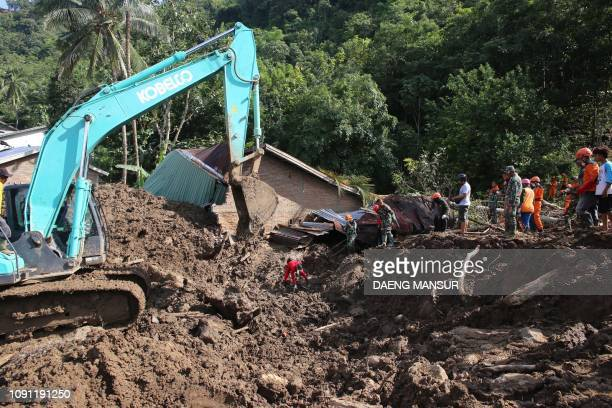 Indonesian search and rescue personnel search for victims in Manuju subdistrict Gowa regency South Sulawesi on January 30 following flooding and...