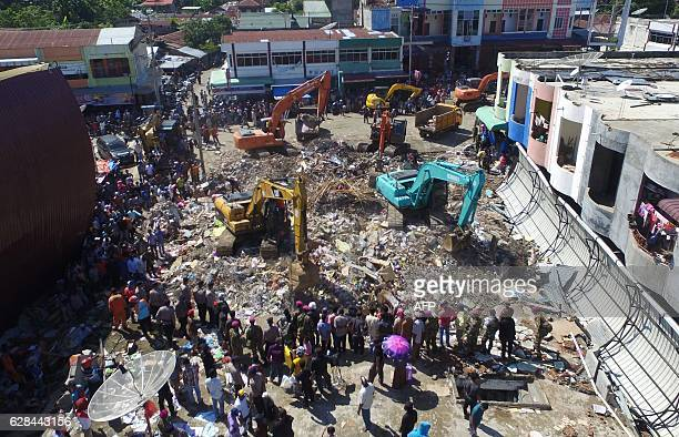 Indonesian search and rescue team continue looking for survivors after a 65 Magnitude earthquake in Pidie Jaya Aceh province on December 8 2016...