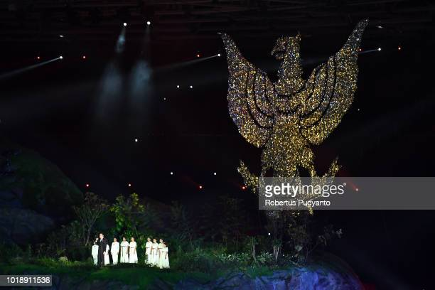 Indonesian singer Tulus performs during the opening ceremony of the Asian Games 2018 at Gelora Bung Karno Stadium on August 18 2018 in Jakarta...
