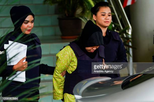 Indonesian Siti Aisyah and Vietnamese Doan Thi Huong escorted by police officers are seen after a court session for their management case at the Shah...