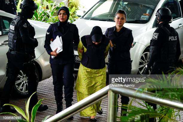Indonesian Siti Aisyah and Vietnamese Doan Thi Huong escorted by police officers arrive at court session for their management case at the Shah Alam...