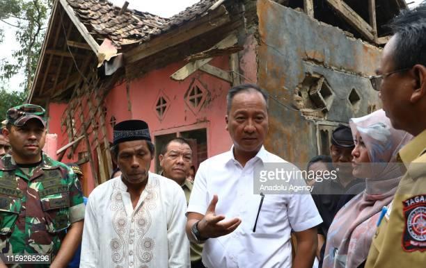 Indonesian Social Minister Agus Gumiwang Kartasasmita visits the earthquakeaffected location in Panjang Jaya Village Banten Indonesia on 3 August...