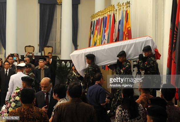 Indonesian soldiers carry the coffin of Indonesian Ambassador of Pakistan Burhan Muhammad during a funeral ceremony in Jakarta Indonesia on 19 May...