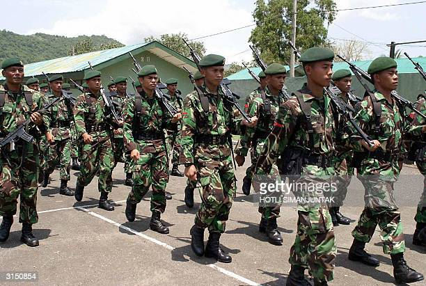 Indonesian soldiers march as they prepare to secure the 2004 general election in Banda Aceh 29 March 2004 Acehnese will vote under martial law which...