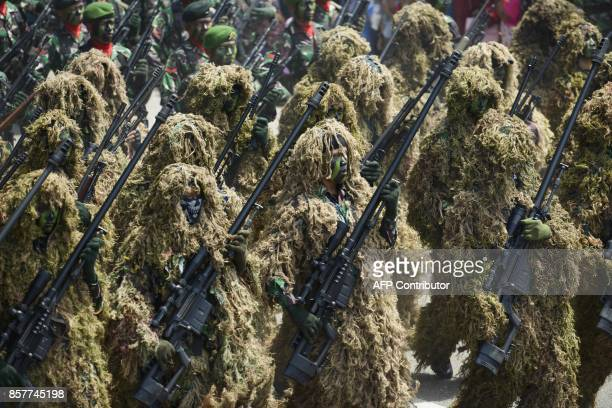 Indonesian soldiers march during a parade to mark the 72nd anniversary of the Indonesian military's founding in Banda Aceh on October 5 2017 / AFP...