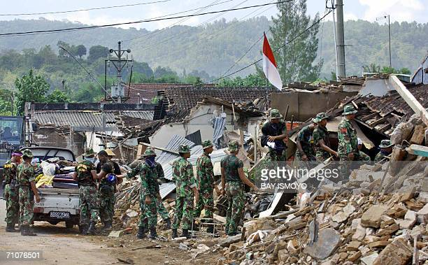 Indonesian soldiers remove goods from collapsed houses in Bantul, Yogyakarta, 30 May 2006. Countries across the world dispatched aid for tens of...