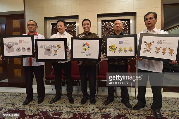 Indonesian Sport and Youth Minister Imam Nachrowi holds the new logo for the 2018 Asian Games as head of the president's staff Teten Masduki head of...
