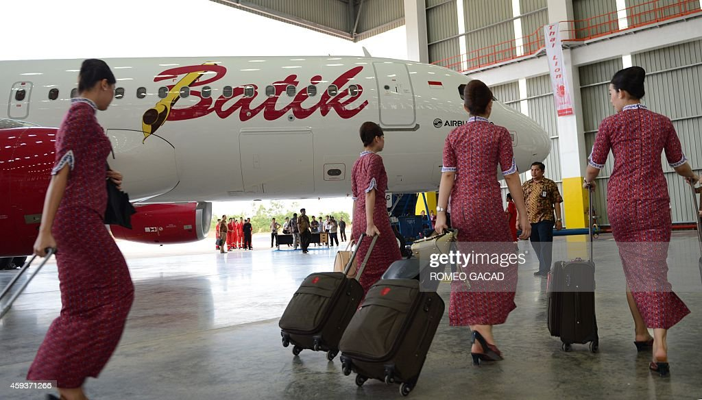 Indonesian stewardesses of indonesias premier service batik air indonesian stewardesses of indonesias premier service batik air board the new airbus a320 on november 21 stopboris Image collections