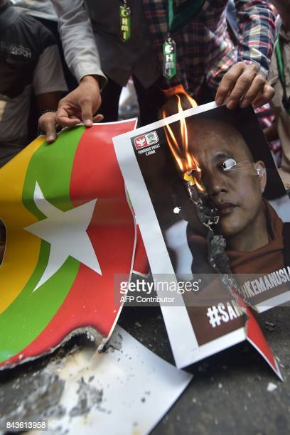 Indonesian students from HMI burn an image of the Myanmar national flag and a poster featuring Myanmar's ultranationalist Buddhist monk Wirathu...