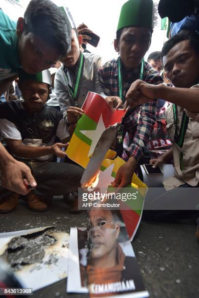 Indonesian students from HMI burn images of the Myanmar national flag and a poster featuring Myanmar's ultranationalist Buddhist monk Wirathu during...