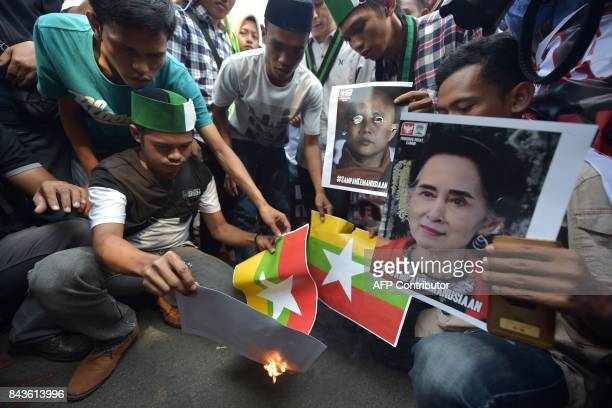 Indonesian students from HMI burn images of the Myanmar national flag during a protest against Myanmar government's handling of the Rohingya crisis...