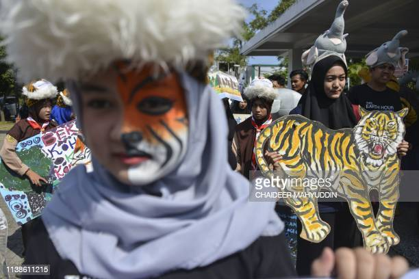 Indonesian students participate in an Earth Day rally in Banda Aceh on April 22 2019