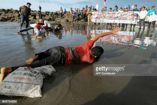 Indonesian students take part in a theatrical protest against Myanmar government's handling of the Rohingya crisis in Banda Aceh on September 7 2017...