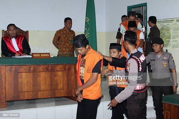 Indonesian suspects charged for the gangrape and murder of a 14year old schoolgirl are produced in court in Curup Bengkulu province on August 4 2016...